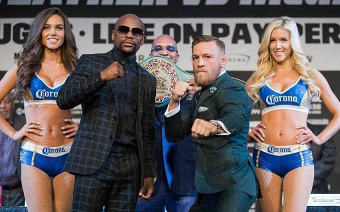 Conor McGregor and Floyd Mayweather at a press conference ahead of their fight on Saturday. Picture: Twitter/@therealzachp
