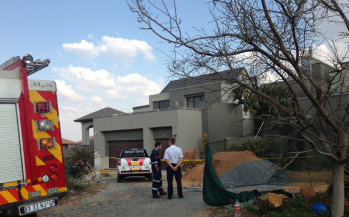 Paramedics and police at the scene of a building collapse in Meyersdal on 18 of August 2014. Picture: Masego Rahlaga/EWN.