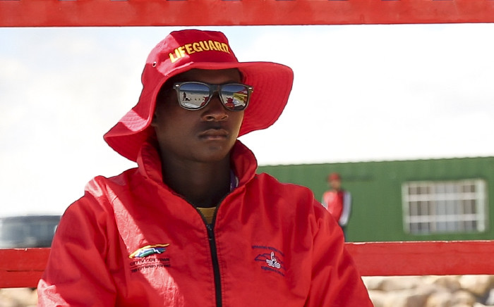A lifeguard keeps watch over swimmers on Monwabisi beach near Khayelitsha, Cape Town. Picture: EWN