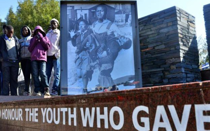 FILE: 12 year-old Hector Pieterson (seen on the picture at L) was shot on 16 June, 1976 during the Soweto uprising that today is a symbol of resistance to the brutality of the apartheid government. Picture: AFP.
