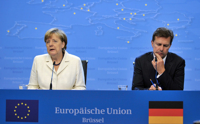 German Chancellor Angela Merkel (L) holds a press conference at the end of talks over the Greek debt crisis in Brussels on 13 July, 2015. EU President Donald Tusk said that eurozone leaders had reached a unanimous deal to offer Greece a third bailout and keep it in the euro after 17 hours of marathon talks. Picture:  AFP.