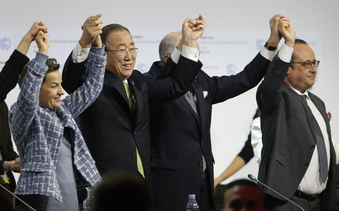 (L-R) Executive Secretary of the United Nations Framework Convention on Climate Change (UNFCCC) Christiana Figueres, Secretary General of the United Nations Ban Ki Moon, Foreign Affairs Minister and President-designate of COP21 Laurent Fabius, and France's President Francois Hollande raise hands together after adoption of a historic global warming pact at the COP21 Climate Conference in Le Bourget, north of Paris, on December 12, 2015. Envoys from 195 nations on December 12 adopted to cheers and tears a historic accord to stop global warming, which threatens humanity with rising seas and worsening droughts, floods and storms. Picture: AFP.