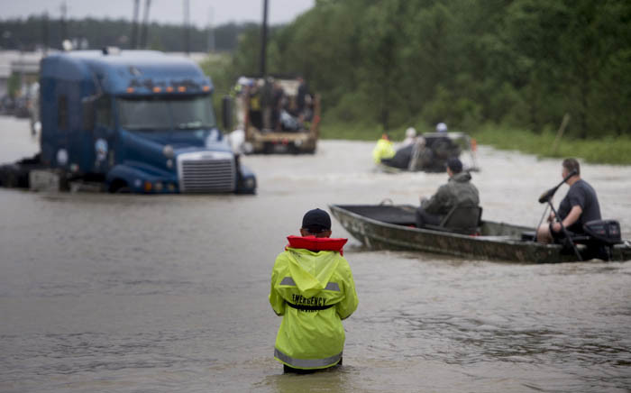 Local residents are evacuated on an air boat operated by volunteers from San Antonio in the Clodine district after Hurricane Harvey caused heavy flooding in Houston, Texas, on 29 August 2017. Picture: AFP
