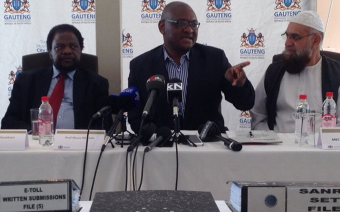 Gauteng premier David Makhura receiving the e-tolls report from the assessment panel in Parkton on 30 November 2014. Picture: Vumani Mkhize