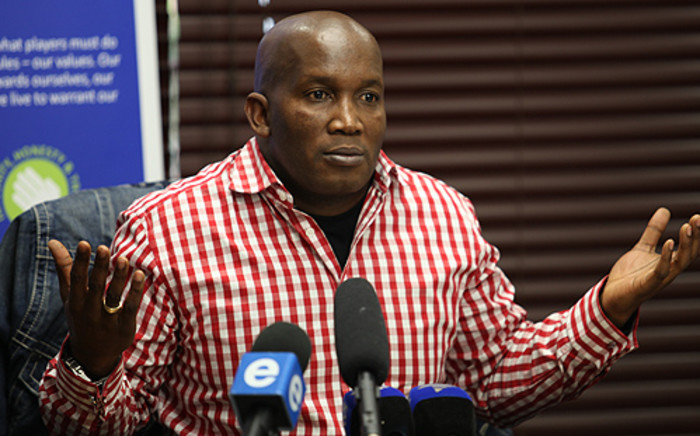 Lonmin's executive vice-president of human capital and external affairs Bernard Mokwena speaks after 9 people were killed in mine violence. Picture: Taurai Maduna/EWN.