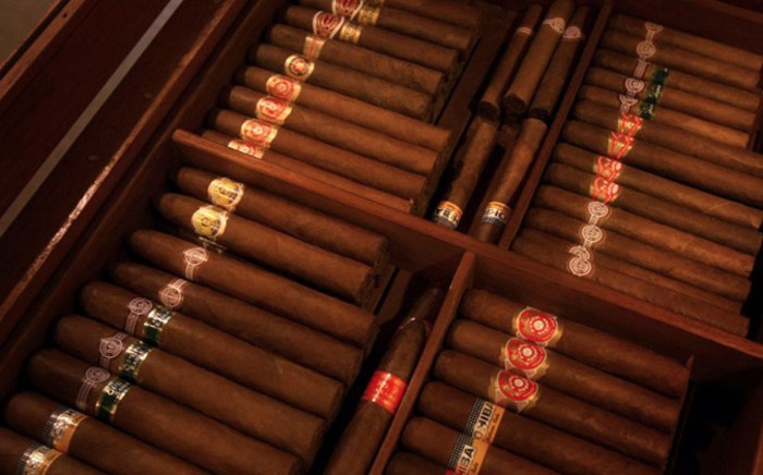 FILE: Dozens of Cuban cigars inside a temperature-controlled room at a cigar club. Picture: AFP.