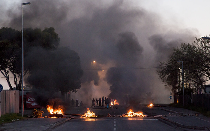 FILE: Protesting Langa residents closed Bhunga Avenue by burning tyres and littering the road with debris. Picture: Thomas Holder/EWN.