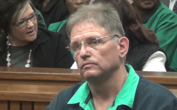 The man dubbed the 'Modimolle Monster', Johan Kotze, moments before he received a life sentence in the North-Gauteng High Court on 17 July 2013 for organising the gang-rape of his ex-wife Ina Bonnette and killing her son. Picture: Reinart Toerien/EWN