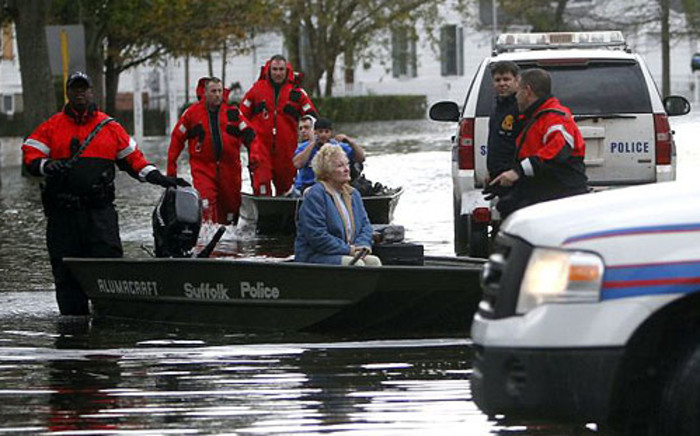 Rescue teams transport residents of Babylon, New York after Superstorm Sandy hit the area on 30 October 2012. Picture: Twitte