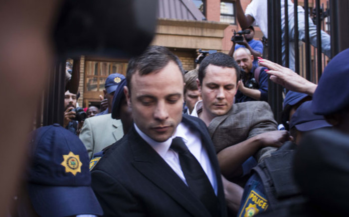 FILE. Oscar Pistorius leaves the Hight Court in Pretoria after the reading of judgment in his murder trial on 12 September 2014. Picture: Christa Eybers/EWN.