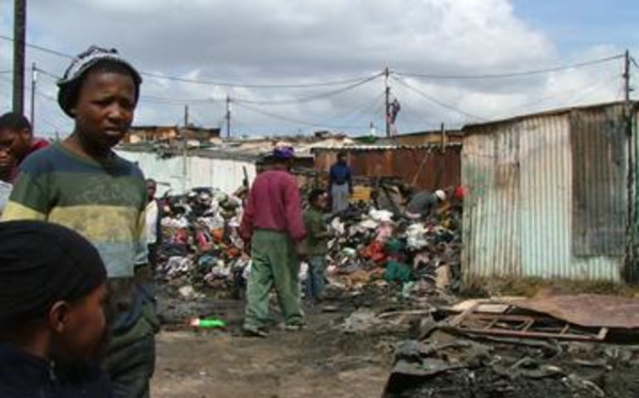 Residents informal settlements wait for permanent housing