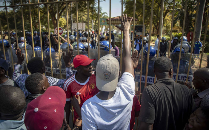 Protesters marched from the MDC headquarters to the ZEC office at Rainbow Towers, Harare, to protest against the election process on 1 August 2018. They were met by riot police armed with rubber bullets, tear gas, and AKs. Picture: Thomas Holder/EWN