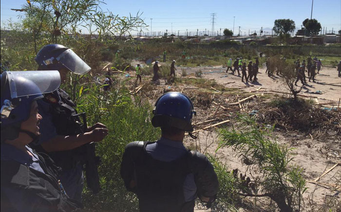 FILE: Law enforcement on Wednesday completely destroyed all the structures built by Khayelitsha residents who illegally invaded a piece of land in the township. Picture: Thomas Holder/EWN