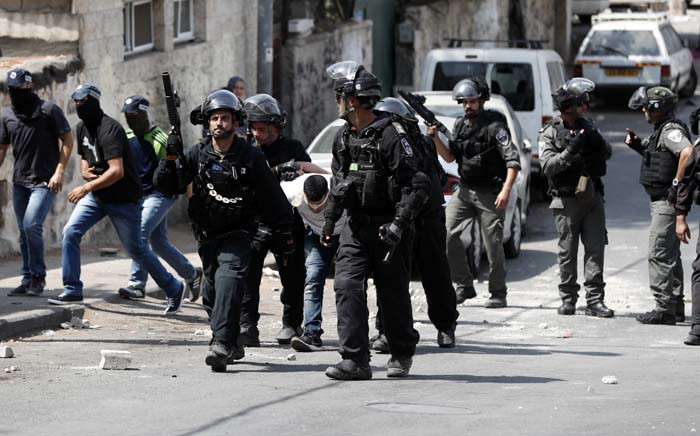 FILE: Israeli security forces detain a Palestinian protester during clashes after border guards dispersed Muslim worshippers with tear gas following prayers outside Jerusalem's Old City on 21 July 2017. Picture: AFP.