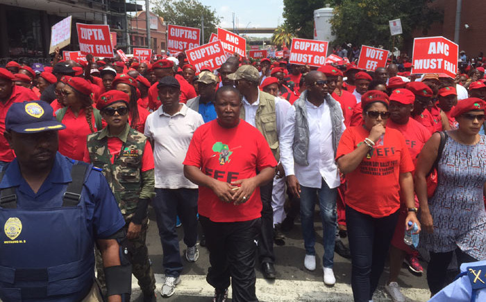 EFF leader Julius Malema walks ahead of party members as they march on the Constitutional Court on Tuesday 9 February 2016. Picture: Vumani Mkhize/EWN.