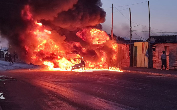 A vehicle burns in Nyanga after being set alight on 2 June 2021. Picture: JP Smith