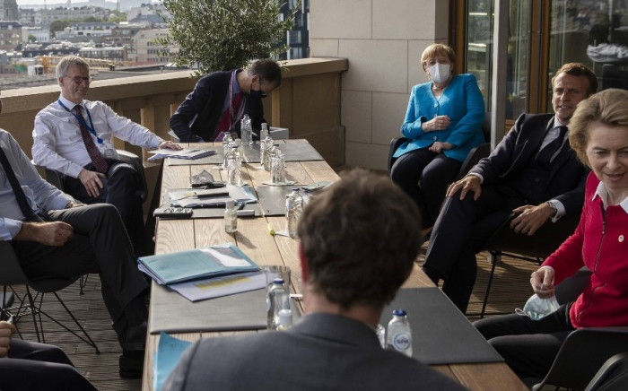 European Council President Charles Michel (L), German Chancellor Angela Merkel (3rd R), French President Emmanuel Macron (2nd R), and European Commission President Ursula von der Leyen (R) meet on the sidelines of an EU summit on a coronavirus recovery package at the European Council building in Brussels on 18 July 2020. Picture: AFP