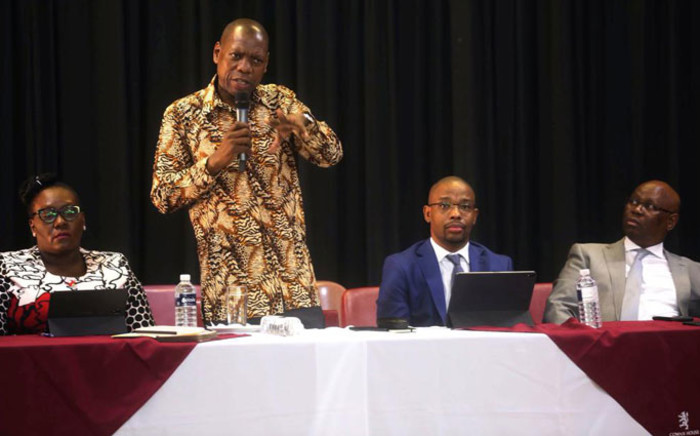 From left: KZN Health MEC Nomagugu Simelane-Zulu, Health Minister Zweli Mkhize and KZN Education MEC Kwazi Mshengu speak to the parents of Cowan House Prep and principals in the Mgungundlovu District on 6 March 2020. A parent at the school is the first person in South Africa to be diagnosed with the coronavirus. Picture: @DBE_KZN/Twitter