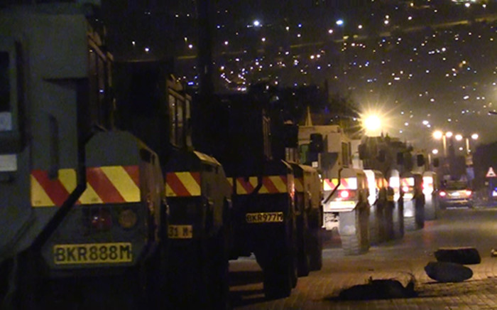 Army truck line up before entering Alexandra Township. Violence broke out yet again on Friday 9 May 2014. Picture:Vumani Mkhize/EWN