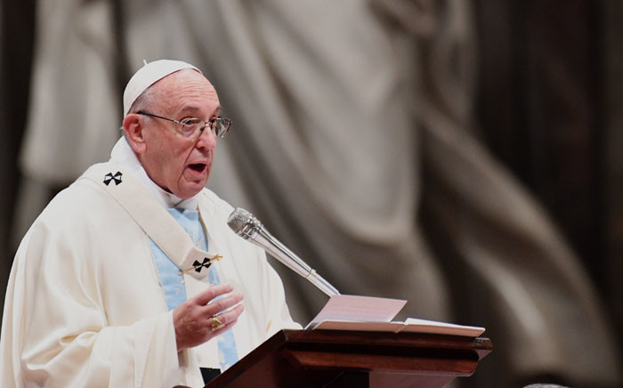 FILE: Pope Francis delivers his message as he leads the holy mass to mark the world day of peace in St Peter's Basilica at the Vatican on 1 January 2018. Picture: AFP.
