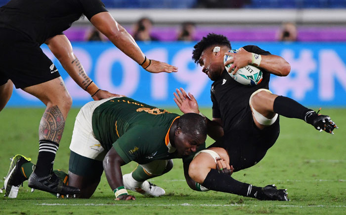 New Zealand's flanker Ardie Savea (R) is tackled by South Africa's prop Trevor Nyakane during the 2019 Rugby World Cup Pool B match between New Zealand and South Africa at the International Stadium Yokohama in Yokohama, Japan on 21 September 2019. Picture: AFP