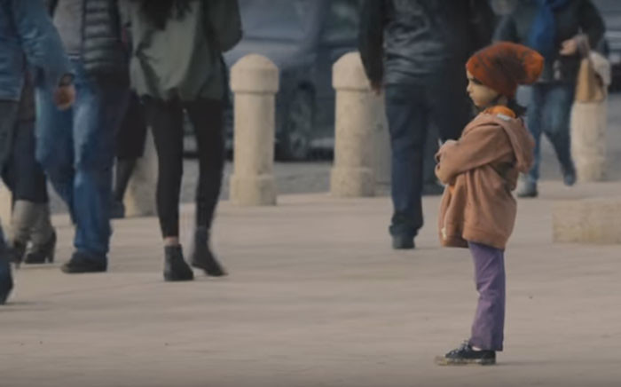 Youtube screengrab of the Unicef social experiment on how people treat impoverished looking children versus clean looking children.