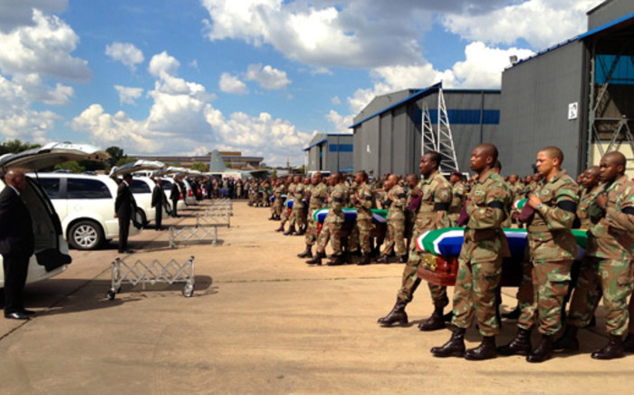 SANDF soldiers carry the bodies of their colleagues killed in the Central African Republic on 24 March 2013. Picture: Alex Eliseev/EWN