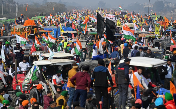 Farmers take part in a tractor rally as they continue to demonstrate against the central government's recent agricultural reforms in New Delhi on January 26, 2021. Money SHARMA / AFP
