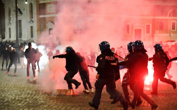 Italian police officers clash with far-right Forza Nuova party activists during a protest against the government restriction measures to curb the spread of COVID-19, at central Piazza del Popolo, in Rome, Italy on October 24, 2020. Picture: AFP
