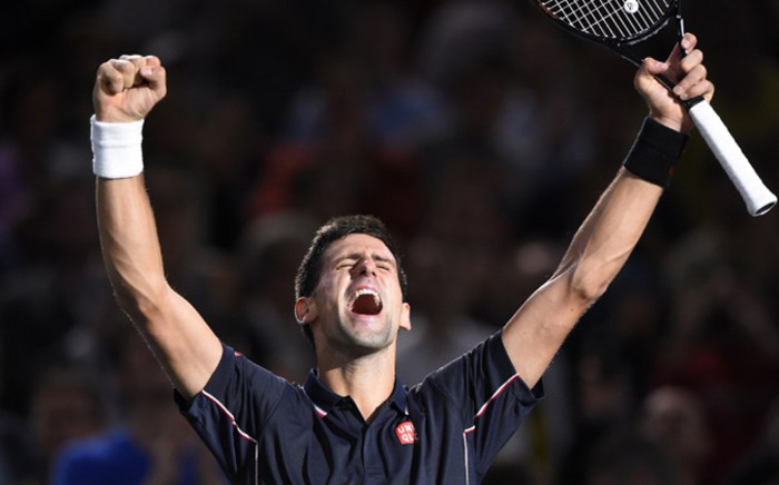 Serbia's Novak Djokovic celebrates his victory against Canada's Milos Raonic at the ATP World Tour Masters. Picture: AFP.