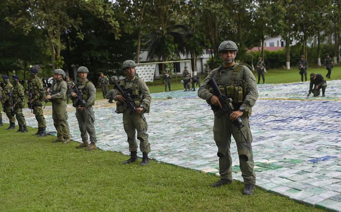 FILE: This handout picture released by Colombia's Presidency shows anti-narcotics police members guarding over 12 tonnes of cocaine on 8 November, 2017 in Apartado, Antioquia, Colombia. Picture: AFP