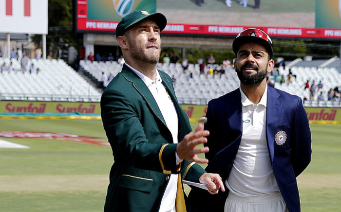 Proteas captain Faf du Plessis tosses the coin while India captain Virat Kohli looks on ahead the Test match against India at Newlands on 5 January 2018. Picture: AFP