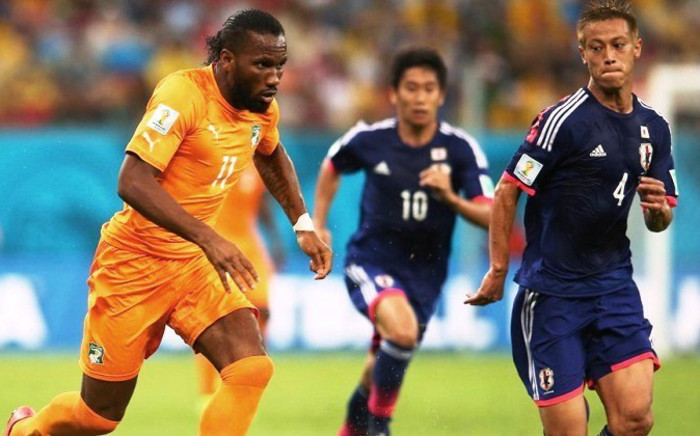 Didier Drogba of the Ivory Coast controls the ball against Keisuke Honda of Japan during their Group C match against Japan at Arena Pernambuco, 14 June 2014, Recife, Brazil. Picture: Fifa.