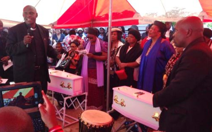 FILE: Mourners gather around the tiny coffins of Yonelisa and Zandile Mali on 19 October 2013 after they were found raped and murdered in Diepsloot. Picture: EWN