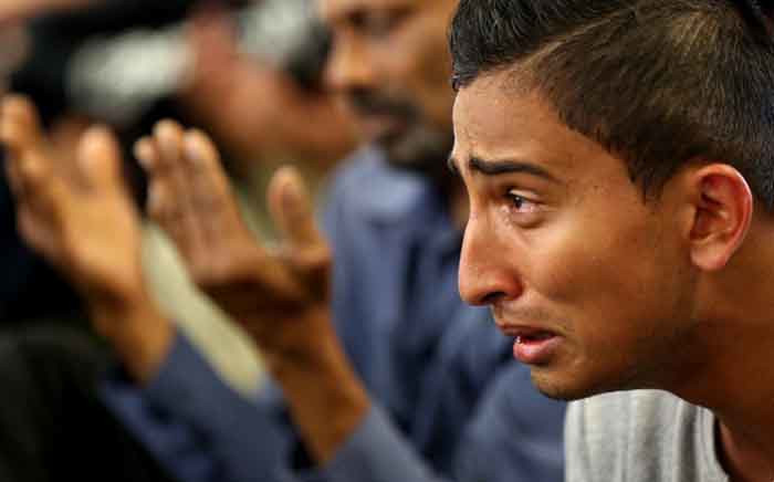 A youth cries during congregational Friday prayers at the Jamia Masjid mosque in Hamilton on 22 March  2019, one week after the Christchurch twin mosque massacre. Picture: AFP