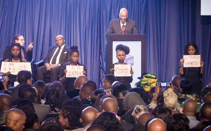 Four women staged a silent anti-rape protest during President Jacob Zuma's address at the IEC briefing on 6 August 2016. Picture: Thomas Holder/EWN.