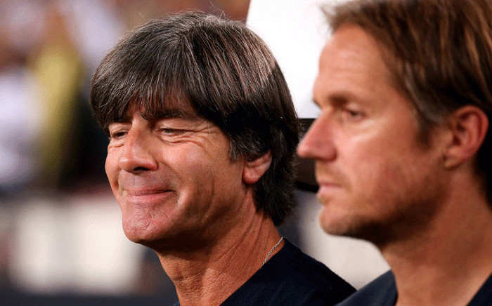 German football coach Joachim Löw (L) smiles after his team beat Norway 6-0 n their Group C match for the World Cup in Russie. Picture: @DFB_Team_EN