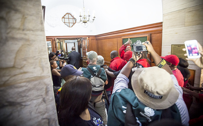Economic Freedom Fighters leader Julius Malema along with MPs being escorted out of Parliament on 12 February 2015. Picture: Thomas Holder/EWN.