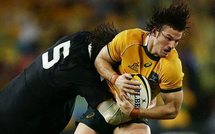 Rob Horne of the Wallabies is tackled during The Rugby Championship match between the Australian Wallabies and the New Zealand All Blacks on 16 August 2014. Picture: Facebook.