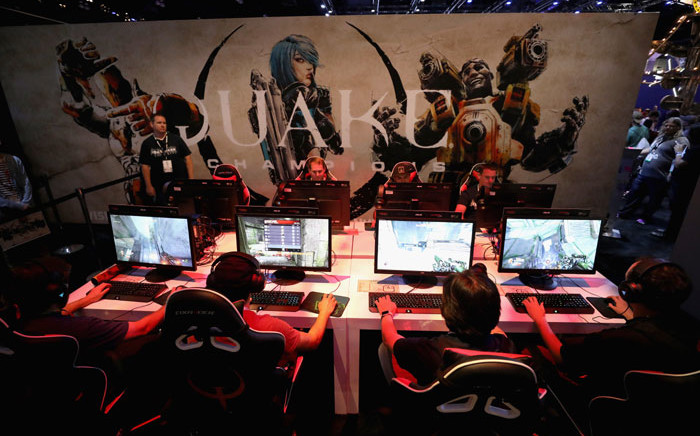 FILE: Game enthusiasts and industry personnel play 'Quake Champions' during the Electronic Entertainment Expo E3 at the Los Angeles Convention Center on 12 June 2018 in Los Angeles, California. Picture: AFP