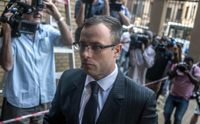 Paralympic athlete Oscar Pistorius arrives at the High Court for the second day of sentencing in his trial in Pretoria on 14 October 2014. Picture: Ihsaan Haffejee/EPA.
