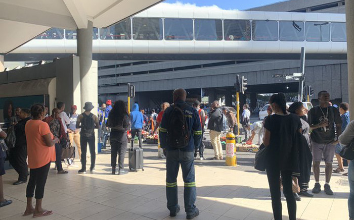 Commuters are standing outside the Cape Town train station on 27 February 2020 after services were suspended due electricity non-payment to Eskom. Picture: Kaylynn Palm/EWN.