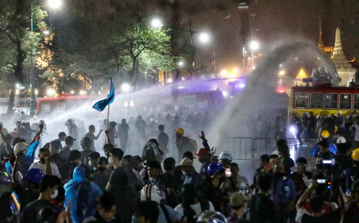 Police use water cannons on pro-democracy protesters to disperse them during an anti-government demonstration in Bangkok on 8 November 2020. Picture: AFP