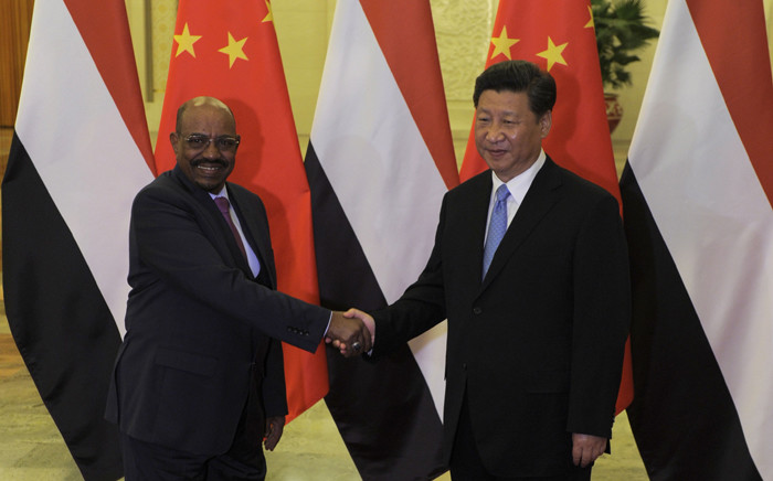 Chinese President Xi Jinping (R) shakes hands with Sudanese President Omar al-Bashir before their meeting at the Great Hall of the People in Beijing on 1 September 2015. Al-Bashir is in Beijing to attend Chinas huge military parade on 3 September marking Japan's defeat in World War II. Picture: AFP.
