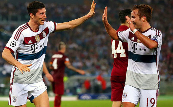 Robert Lewandowski and Mario Götze of Bayern Munich celebrate after their 7-0 hammering of AS Roma in the Uefa Champions League group game on 21 October 2014. Picture: Official Uefa Facebook page.