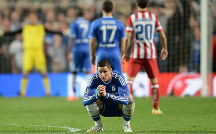 Chelsea's Fernando Torres sit down in despair after his team were knocked out of the Champions League by Atletico Madrid on 30 April 2014. Picture: Facebook.