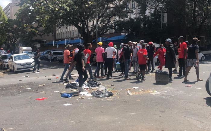 A small group of protesting students blocked roads with stones and rubble in Braamfontein near Wits University as part of the National Shutdown over student finances on 15 March 2021. Picture: Mia Lindeque/Eyewitness News