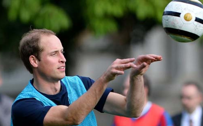 UNITED KINGDOM, London : Britain's Prince William, the Duke of Cambridge takes part in a football training session in the garden of Buckingham Palace in central London on October 7, 2013, prior to a football match to mark the Football Association's 150th anniversary. AFP PHOTO / BEN STANSALL