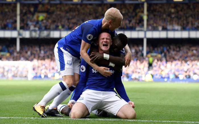 Wayne Rooney and teammates celebrate after the former Manchester United player scored a goal against Stoke City. Picture: Twitter/@Everton.