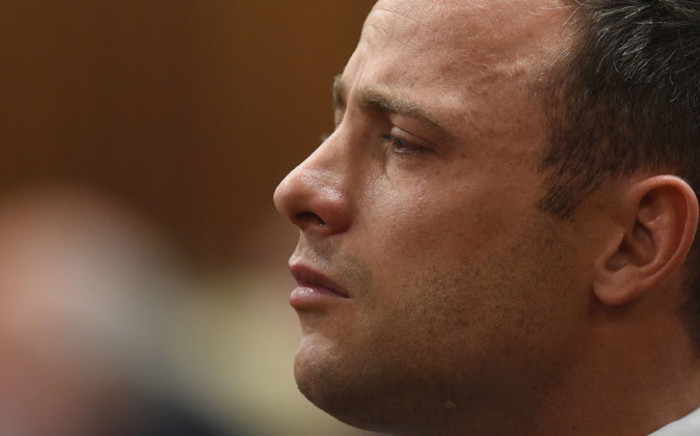 Oscar Pistorius in the dock as judgment is handed down in his murder trial at the High Court in Pretoria on 11 September 2014. Picture: Pool.